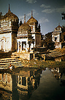 India: Indian Temples. A series of small sanctuaries around a pool--one of a series of small temples on the road from Jabalpur to the Narmada River, Madhya-Pradesh State. J-L Nov. INDIAN TEMPLES.