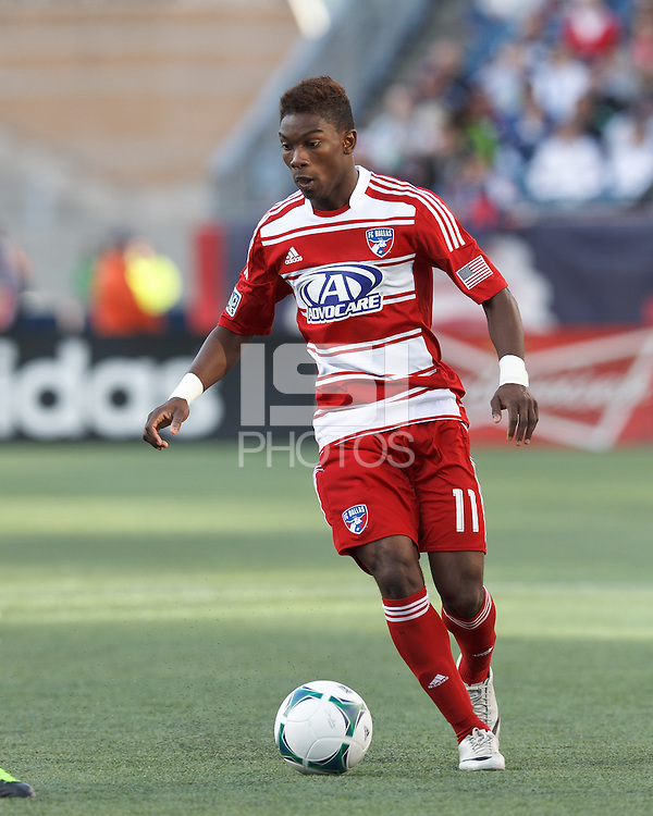 FC Dallas defender Fabian Castillo (11) on the attack. .  In a Major League Soccer (MLS) match, FC Dallas (red) defeated the New England Revolution (blue), 1-0, at Gillette Stadium on March 30, 2013.