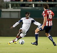 Revolution defender Emmanual Osei (5) makes a move past Chivas forward Alan Gordon (16) during the first half of the game between Chivas USA and the New England Revolution at the Home Depot Center in Carson, CA, on September 10, 2010. Chivas USA 2, New England Revolution 0.