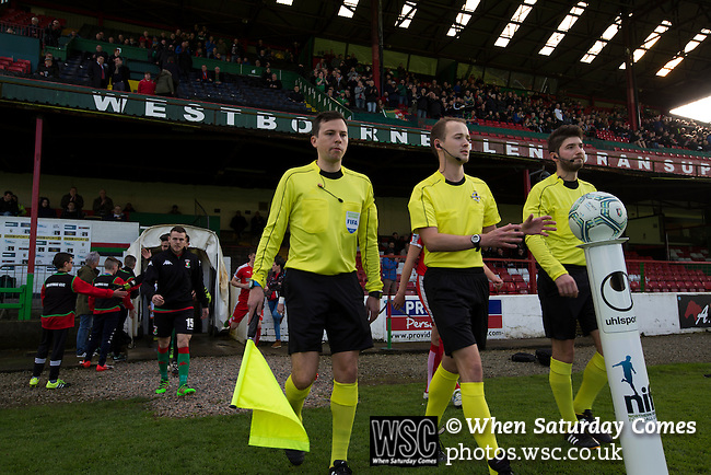 Glentoran 2 Cliftonville 1, 22/10/2016. The Oval, NIFL Premiership. The referee and his assistants leading the players on to the pitch at The Oval, Belfast before Glentoran hosted city-rivals Cliftonville in an NIFL Premiership match. Glentoran, formed in 1892, have been based at The Oval since their formation and are historically one of Northern Ireland's 'big two' football clubs. They had an unprecendentally bad start to the 2016-17 league campaign, but came from behind to win this fixture 2-1, watched by a crowd of 1872. Photo by Colin McPherson.