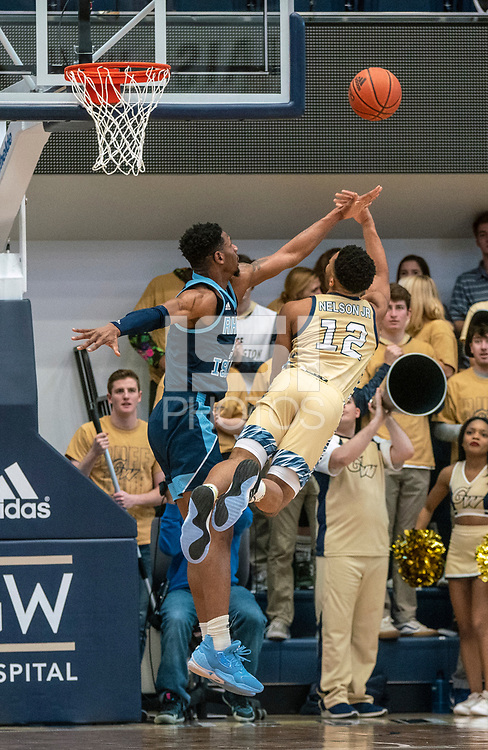 WASHINGTON, DC - FEBRUARY 8: Jameer Nelson Jr. #12 of George Washington launches a shot past Cyril Langevine #10 of Rhode Island during a game between Rhode Island and George Washington at Charles E Smith Center on February 8, 2020 in Washington, DC.