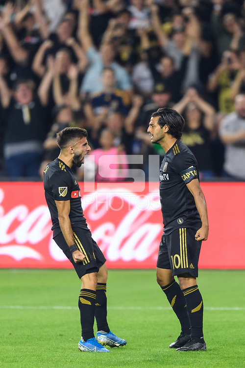 Los Angeles, CA - October 24, 2019.  Carlos Vela celebrates the first of his two goals with Diego Rossi as LAFC defeated the Los Angeles Galaxy 5 - 3 in the Western Conference semifinal match at Banc of California stadium in Los Angeles.