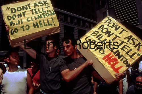 """Gay activists protest the military """"Don't Ask, Don't Tell"""" policy on homosexuals in the armed forces in Times Square in New York in front of the military recruitment office in 1993. (© Frances M. Roberts)"""