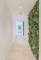 BNPS.co.uk (01202 558833)<br /> Pic: Strutt&Parker/BNPS<br /> <br /> 'Living Wall' within the property...<br /> <br /> A former WW2 battery, with unrivalled views across the channel to France, has come on the market - but you'll need deep pockets to shell out on its stunning location.<br /> <br /> The cliff top gun emplacement was rapidly constructed in 1940, as Britsh troops were fleeing Dunkirk, and has now been transformed into a £6million 'James Bond style' property.<br /> <br /> The Gunnery, near Kingsdown in Kent offers 'incredible' views of the Channel, with the iconic White Cliffs of Dover visible to the west, and France to the south, while also coming with six acres of sandy beach.<br /> <br /> The unique 82ft long property is accessed by an underground tunnel that leads through the cliff to a glass lift which travels up to it. Another secret tunnel inside the four bedroom home, which is just a few feet from the cliff edge, provides passage to a home cinema.<br /> <br /> The 50ft long living room has floor to ceiling windows and the original gun loops can still be seen.