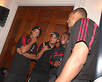 Dida looks at Ronaldinho, Mancini and Marcus Diniz of AC Milan at a reception for AC Milan at DAR Constitution Hall in Washington DC on May 24 2010.