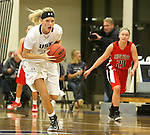 SIOUX FALLS, SD - DECEMBER 8:  Teagan Molden #30 from the University of Sioux Falls scoops up the loose ball against Minot State Friday night at the Stewart Center.(Photo by Dave Eggen/Inertia)