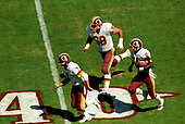 Washington Redskins quarterback Joe Theismann (7) and offensive guard Russ Grimm (68) lead the blocking for wide receiver Art Monk (81) as he carries the ball upfield during the game against the Houston Oilers at RFK Stadium in Washington, DC on September 16, 1985.  The Redskins won the game 16 - 13. <br /> Credit: Howard L. Sachs / CNP