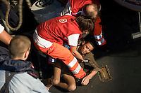 Lampedusa,2011. Volontari del Cisom, il Corpo di Soccorso dell'Ordine di Malta, impegnati nelle operazioni di salvataggio di immigrati.<br /> Immigrants saved by the Italian Coast Guard