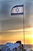 Flag of Israel at sunset