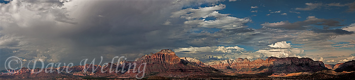 999400010 thunderstorms and clouds form over west temple and zion geological formations in this panoramic  view from a backcountry scenic byway near hurricane utah