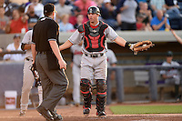 Great Lakes Loons catcher Kyle Farmer (8) argues a call with umpire Richard Riley during a game against the West Michigan Whitecaps on June 5, 2014 at Fifth Third Ballpark in Comstock Park, Michigan.  West Michigan defeated Great Lakes 6-2.  (Mike Janes/Four Seam Images)
