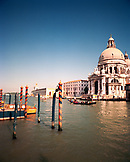 ITALY, Venice, a gondola in the Grand Canal with the Basilica of St. Mary in the background.