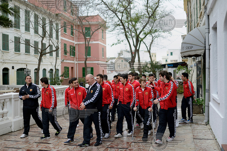 Players from the Gibraltarian under-17 national team  walk near their hotel prior to a match against Northern Ireland played in March 2013. Although the United Nations doesn't recognise Gibraltar as an independent country, UEFA has recognised it and has granted the British Overseas Territory full UEFA membership.