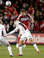 Chicago Fire midfielder Logan Pause (7) heads the ball over Real Salt Lake forward Yuri Movsisyan (14).  Real Salt Lake defeated the Chicago Fire in a penalty kick shootout 0-0 (5-4 PK) in the Eastern Conference Final at Toyota Park in Bridgeview, IL on November 14, 2009.
