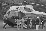 As he boards the White House helicopter after resigning the presidency, August 9, 1974 Washington DC, Richard M. Nixon smiles and waves goodbye -   A break in at the Democratic National Committee headquarters at the Watergate complex on June 17, 1972 results in one of the biggest political scandals the US government has ever seen.  Effects of the scandal ultimately led to the resignation of  President Richard Nixon, on August 9, 1974, the first and only resignation of any U.S. President.