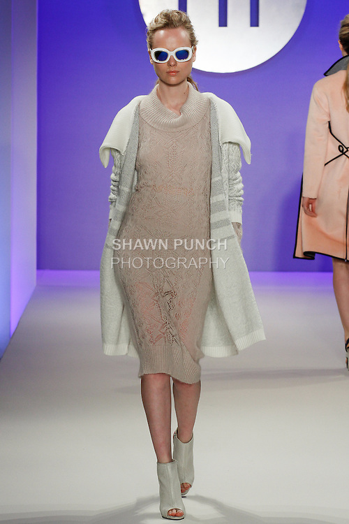 Model walks runway in an outfit by Jeanette Yu, during the FIT Future of Fashion 2014 Graduates' Collection fashion show, at the Fashion Institute of Technology on May 1, 2014.