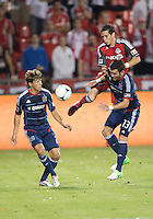 12 September 2012: Toronto FC midfielder Eric Avila #8 battles with Chiacgo Fire midfielder Wells Thompson #2 and Chicago Fire defender Gonzalo Segares #13 during an MLS game between the Chicago Fire and Toronto FC at BMO Field in Toronto, Ontario Canada. .The Chicago Fire won 2-1.