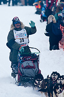Mike Williams team leaves the start line during the restart day of Iditarod 2009 in Willow, Alaska