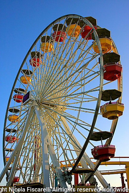 The Santa Monica Pier in California, offers many fun attractions for people of different ages: an amusement park, restaurants, fishing or just sitting back and  enjoying people watching activity.