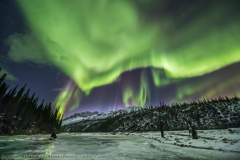 Photographers take pictures of the aurora borealis in Alaska's Brooks Range, Arctic, Alaska