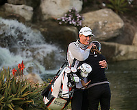 24 MAR 13  Caddie Andreaus Thorp hugs Beatriz Ricari on the 18th green at the conclusion of Sundays Playoff at the Final Round of The KIA Classic at Aviara Golf Club in Carlsbad, California. (photo:  kenneth e.dennis / kendennisphoto.com) www.golffile.ie