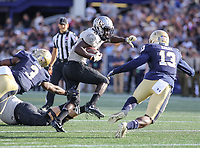 Annapolis, MD - October 21, 2017: UCF Knights running back Adrian Killins Jr. (9) breaks a tackle during the game between UCF and Navy at  Navy-Marine Corps Memorial Stadium in Annapolis, MD.   (Photo by Elliott Brown/Media Images International)