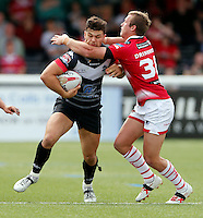Alex Foster (L) is tackled by Josh Drinkwater during the Kingstone Press Championship game between London Broncos and Leigh Centurions at Ealing Trailfinders, Ealing, on Sun June 26,2016