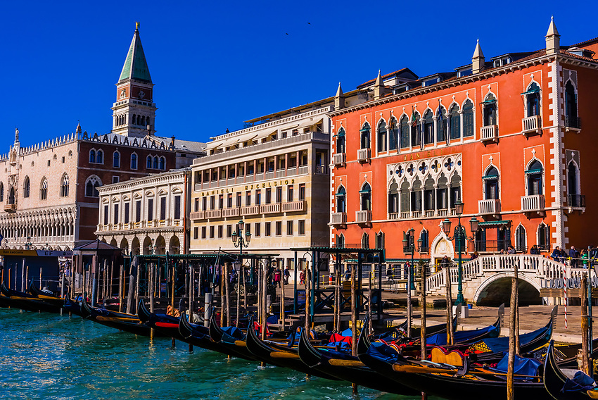 Hotel Danieli on right with Doge's Palace on left and San Marco Campanile (bell tower) in background, Venice, Italy.