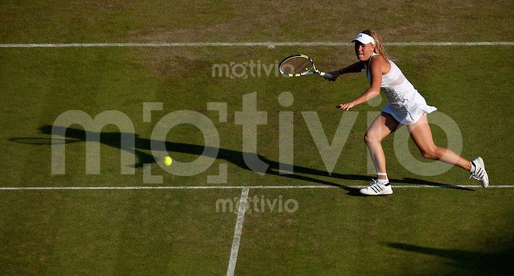 Caroline Wozniacki (DEN) plays against Tathiana Garbin (ITA) on Court 1. The Wimbledon Championships 2010 The All England Lawn Tennis & Croquet Club  Day 2 Tuesday 22/06/2010