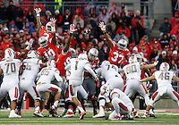 Ohio State special teams players try to block a field goal attempt by Rutgers Scarlet Knights place kicker Kyle Federico (1) during the third quarter of the NCAA football game at Ohio Stadium in Columbus on Oct. 18, 2014. Federico made the 42-yard attempt. (Adam Cairns / The Columbus Dispatch)