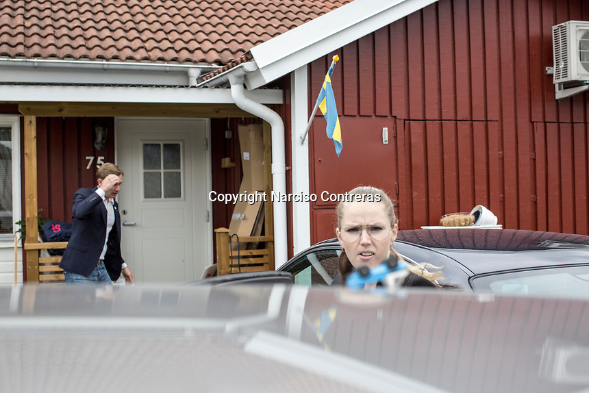 August 30, 2018: ROGER HEDLUND, a 38 years-old MP and member of the SD board in Gävle municipality for the Swedish Democrats (Sverigedemokraterna) and LIZ ZACHARIASSON, a 27 years-old member of the SD since 2009. They get ready prior to a public debate held in Ockelbo city with members of the Social Democrats party (Socialdemokraterna) -not pictured-, Roger and Liz are running for the Gälve and the Ockelbo municipality respectively.
