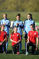 Piscataway, NJ, April 24, 2016. Sky Blue's Sarah Killion (16), Raquel Rodriguez (11), and Erica Skroski (8) await their player introductions.  The Washington Spirit defeated Sky Blue FC 2-1 during a National Women's Soccer League (NWSL) match at Yurcak Field.