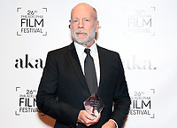 PHILADELPHIA, PA - OCTOBER 26: Bruce Willis receives the 2nd annual Luminere Award from M. Night Shyamalan at the 26th Philadelphia Film Festival at AKA Washington Square in Philadelphia, Pa on October 26, 2017  Credit: Star Shooter/MediaPunch /NortePhoto.com