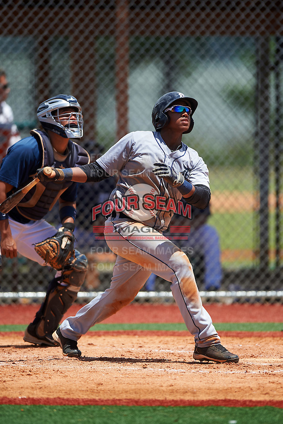GCL Tigers West third baseman Randel Alcantara (25) at bat in front of catcher Elys Escobar during a game against the GCL Tigers East on August 4, 2016 at Tigertown in Lakeland, Florida.  GCL Tigers West defeated GCL Tigers East 7-3.  (Mike Janes/Four Seam Images)
