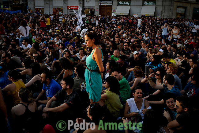 Protesters gather on the Puerta del Sol square in Madrid on May 29, 2011 during a protest against Spain's economic crisis and its sky-high jobless rate. Young people camped in main squares across Spain in the largest spontaneous protests since the country plunged into recession after the collapse of a property bubble in 2008. (c) PEDRO ARMESTRE