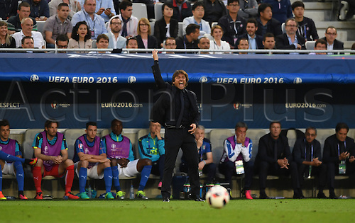 02.07.2016. Bordeaux, France. Italy's coach Antonio Conte (C) reacts during the UEFA EURO 2016 quarter final soccer match between Germany and Italy at the Stade de Bordeaux in Bordeaux, France, 02 July 2016.