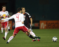 Josh Wolfe (16) of D.C. United sends a pass away from Rafa Marquez (4) of the New York Red Bulls during an MLS match at RFK Stadium, in Washington D.C. on April 21 2011. Red Bulls won 4-0.