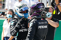 4th July 2020; Red Bull Ring, Spielberg Austria; F1 Grand Prix of Austria, qualifying sessions;  77 Valtteri Bottas FIN, Mercedes-AMG Petronas Formula One Team chats with 44 Lewis Hamilton GBR, Mercedes-AMG Petronas Formula One Team  as Bottas takes pole and Hamilton 2nd