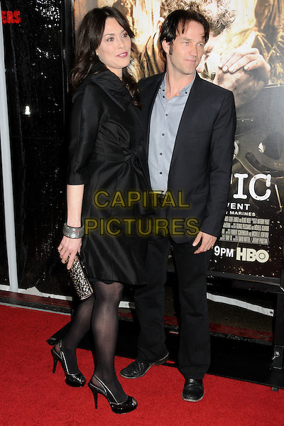 "MICHELLE FORBES & STEPHEN MOYER .HBO's ""The Pacific"" Mini-Series Premiere held at Grauman's Chinese Theatre, Hollywood, California, USA..February 24th, 2010.full length coat tights shoes black suit grey gray blue platform peep toe clutch bag bracelet .CAP/ADM/BP.©Byron Purvis/AdMedia/Capital Pictures."