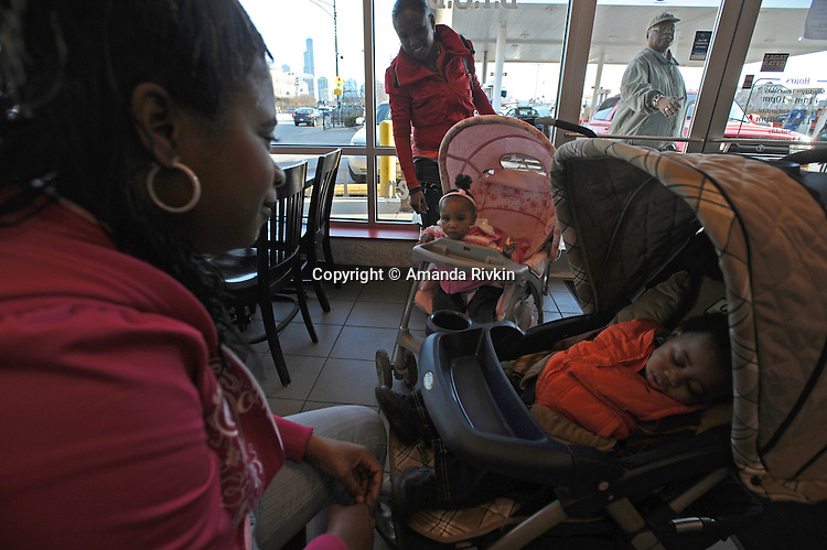 Young mothers with their children at the Hecky's Chicken, the only restaurant on the western border of the Cabrini Green high rise complex in Chicago, Illinois on April 5, 2008.