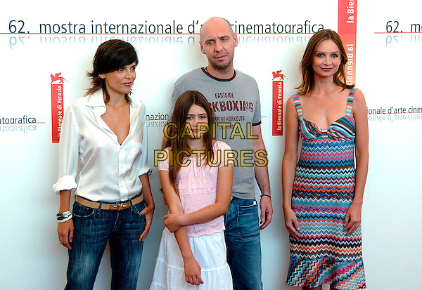 "ELENA ANAYA, YASMIN MURPHY, JAUME BALAGUERO & CALISTA FLOCKHART.Photocall for the film  ""Fragile"" at the 62nd Venice Film Festival.September 2nd, 2005.Ref: OME.half length blue striped pattern print dress white blouse.www.capitalpictures.com.sales@capitalpictures.com.© Capital Pictures."