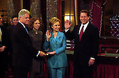 Washington, DC - January 3, 2001 -- Hillary Rodham Clinton is sworn-in as United States Senator from New York by Vice President Al Gore.  Her husband, United States President Bill Clinton and daughter, Chelsea, look on..Credit: Ron Sachs / CNP