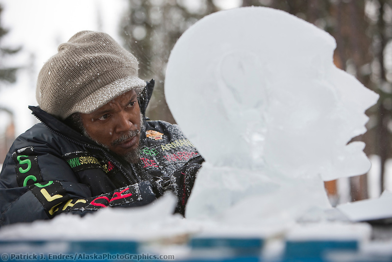 "French sculptor Steve Armance, carves away on a single block, realistic sculpture titled ""Eternal Flame"" during the 2009 World Ice Art Championships in Fairbanks, Alaska."