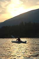 Kayaking at Sunset. Kootenay Lake. West Kootenay region of British Columbia.