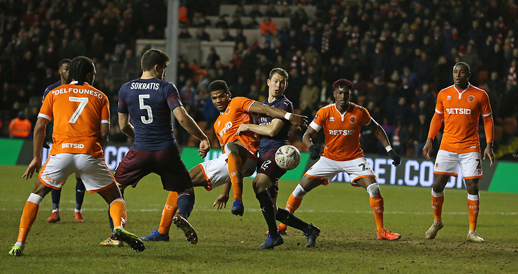 Blackpool's Michael Nottingham battles with Arsenal's Stephan Lichtsteiner as his team seek to score in the second half<br /> <br /> Photographer Stephen White/CameraSport<br /> <br /> Emirates FA Cup Third Round - Blackpool v Arsenal - Saturday 5th January 2019 - Bloomfield Road - Blackpool<br />  <br /> World Copyright © 2019 CameraSport. All rights reserved. 43 Linden Ave. Countesthorpe. Leicester. England. LE8 5PG - Tel: +44 (0) 116 277 4147 - admin@camerasport.com - www.camerasport.com