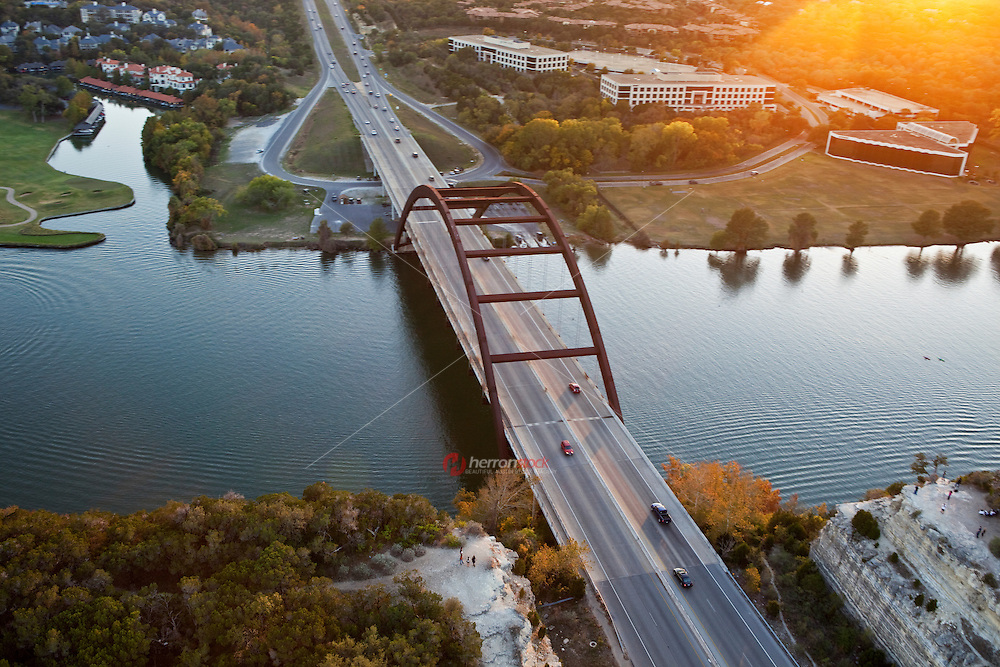 Aerial view at sunset of the Pennybacker 360 bridge on Colorado River near Austin Texas