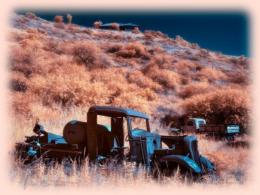 Ghost Trucks, Ghost Town (Infrared) ©2018 James D Peterson.  Jerome, Arizona was once a thriving mining town, before the ore ran out and the population mostly followed suit.  It has more recently been revived as an artist colony and historic tourist destination -- but plenty of ghosts remain.