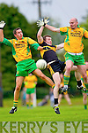 Gneeveguilla's Fergus McAuliffe and Mike B Murphy and Dr Crokes Luke Quinnin fail to pick up the loose ball in Gneeveguilla last Sunday evening in round 1 of the Garvey's Supervalue County Senior Championship.