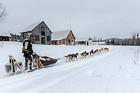 Ed Stielstra runs past old miners cabins on his way to the Ophir Checkpoint on Thursday March 10 during Iditarod 2016.  Alaska.    <br /> <br /> Photo by Jeff Schultz (C) 2016  ALL RIGHTS RESERVED