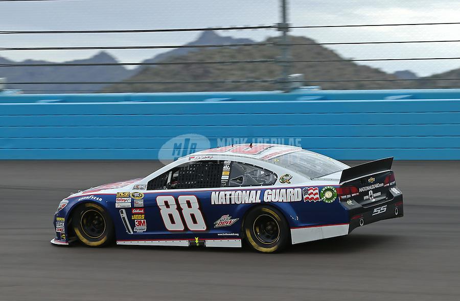 Mar. 3, 2013; Avondale, AZ, USA; NASCAR Sprint Cup Series driver Dale Earnhardt Jr during the Subway Fresh Fit 500 at Phoenix International Raceway. Mandatory Credit: Mark J. Rebilas-